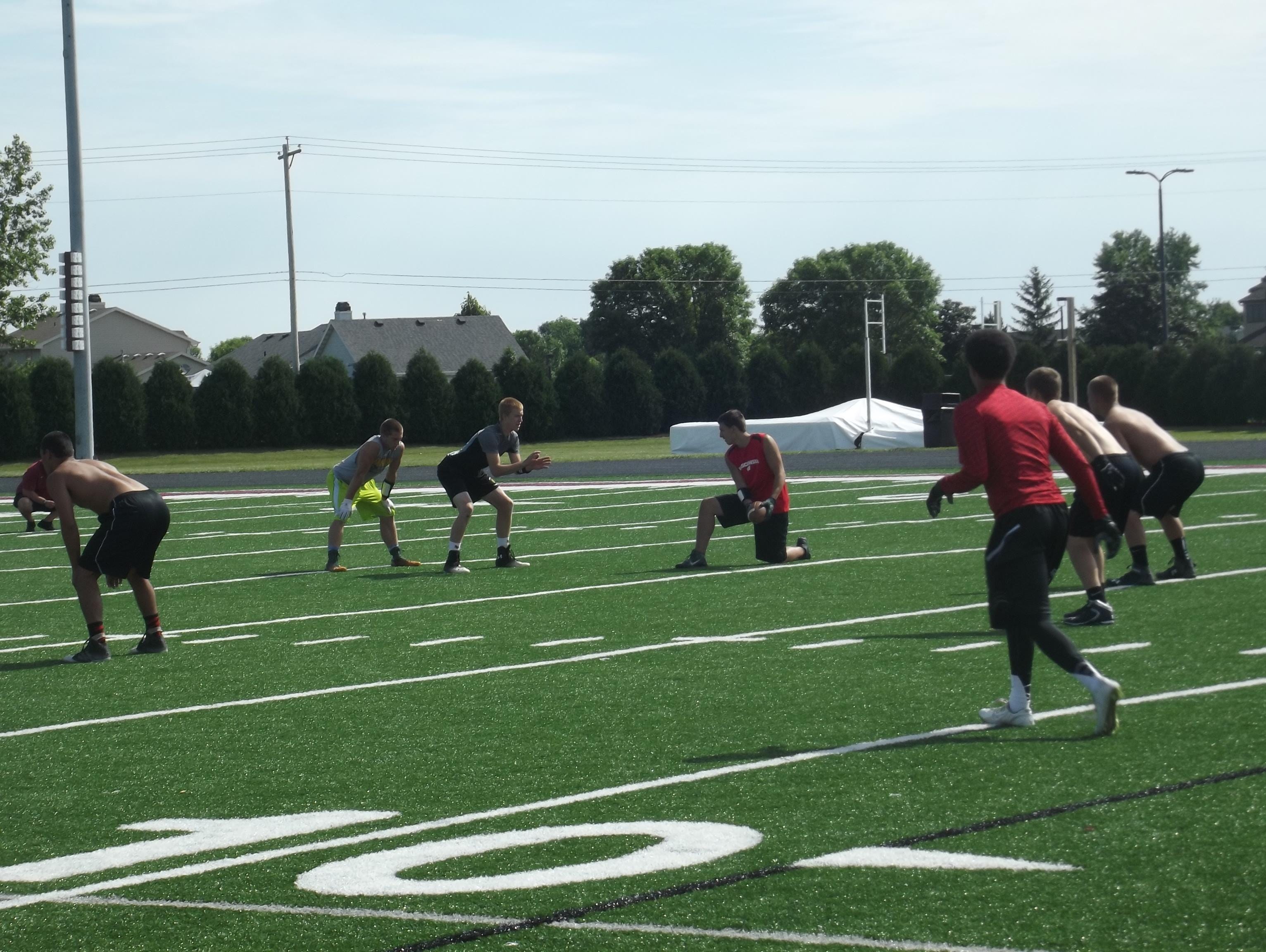 Freedom's Charlie Jadin prepares to take a snap against De Pere in a 7-on-7 football game at De Pere High School on Wednesday. Chris Greisen's third annual Midwest Elite 7-on-7 Tournament takes place Saturday at Green Bay Notre Dame.