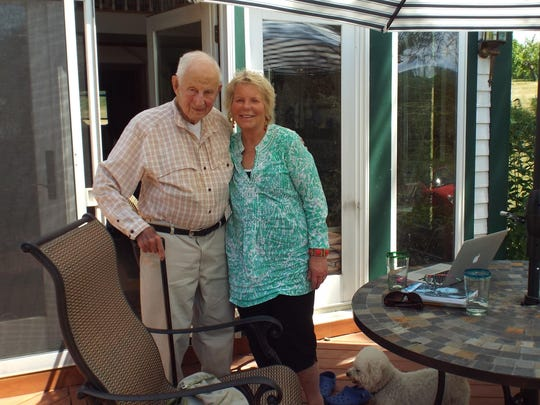 Married 38 years in November, Robert Morgenthau and Lucinda Franks spend a recent Saturday morning with their Bichon Frise pup, Ivan-the-Terrible, on their home's patio that overlooks the family's farm, Fishkill Farms in Hopewell Junction.
