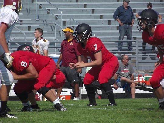 Pulaski senior quarterback Isaac Higgins gets set to take a snap during at scrimmage Luxemburg-Casco High School on Friday.