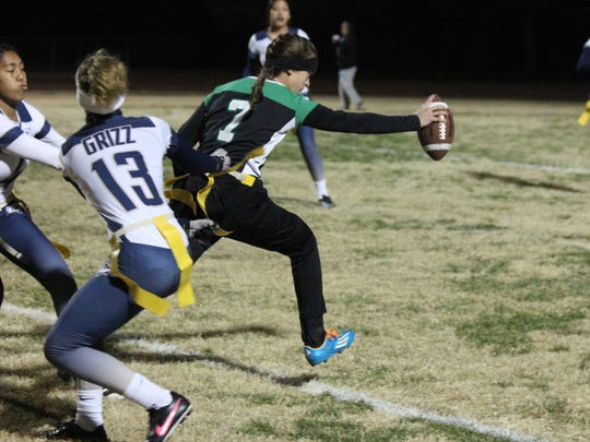Virgin Valley quarterback Kallie Graves stretches the ball across the goal line during Thursday's game against Spring Valley.