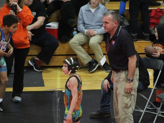 Dylan Mollo, center, of Union-Endicott youth wrestling, gets ready to wrestle in the 65-lb. Novice division at the NY-USA Wrestling Kids State Meet as coach Greg Kleinsmith looks on.