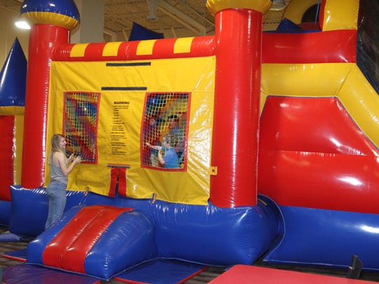 Mary Huff plays with her nephew, Daniel Gomez, 2, at the Big Bounce on Wednesday at the Animas Valley Mall.