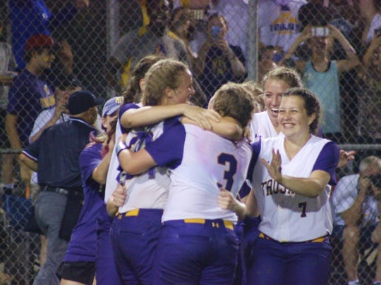 The ASH Lady Trojans celebrate winning the Class 5A softball state championship at Sulphur's Frasch Park in May.