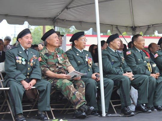Veterans listen during the dedication ceremony for the Hmong - Lao Veterans Memorial Saturday, Sept. 24, 2016