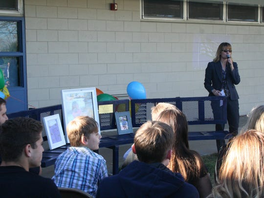 Fernley Elementary School principal Chanen Cross welcomes visitors and students to a ceremony on Nov. 18 dedicating a bench made for former student Haylie Chmela, who died in August 2015 after a battle with brain cancer.