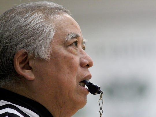OHSAA referee Joe Yoshimura is retiring at the end the season works the game at Hamilton Badin High School, Tuesday, Feb. 14.