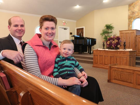 The Rev. Ben Lauritzen, his wife, Kayla, and their son, Micah.