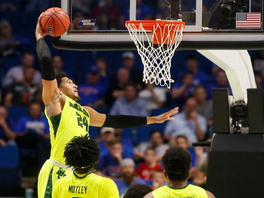 Baylor guard Ishmail Wainright (24) dunking in the first half of a second-round game against USC in the men's NCAA tournament.