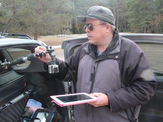 Dennis Pratt of Superior prepares equipment, including