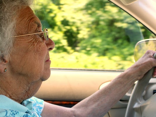 Senior Citizen Woman Driving