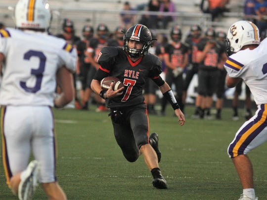 Ryle senior Easton Pilyer heads upfield for a touchdown