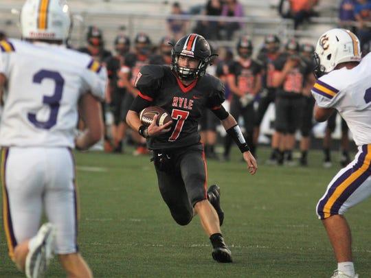 Ryle senior Easton Pilyer heads upfield for a touchdown