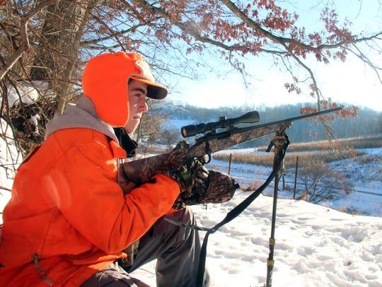 Matthew Ammel of Menomonee Falls watches for deer while