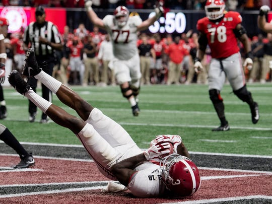 Calvin Ridley catches a touchdown pass to bring Alabama within an extra point of tying the game in the fourth quarter against Georgia in January.