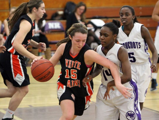 Aaliya Hayes (14) of New Rochelle defends Shannon Lynch