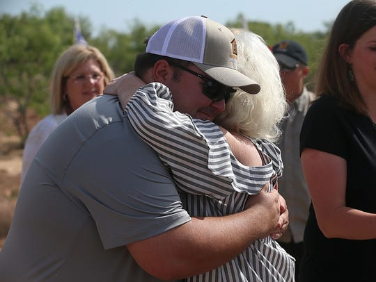 Army Private First ClassIan Rook greets supporters