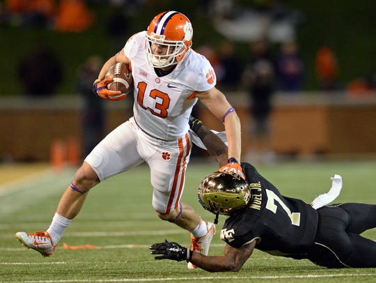 Clemson wide receiver Adam Humphries (13) stiff-arms Wake Forest cornerback Merrill Noel (7) after a reception during the 2nd quarter Thursday, November 6, 2014 at BB&T Field in Winston Salem, N.C.