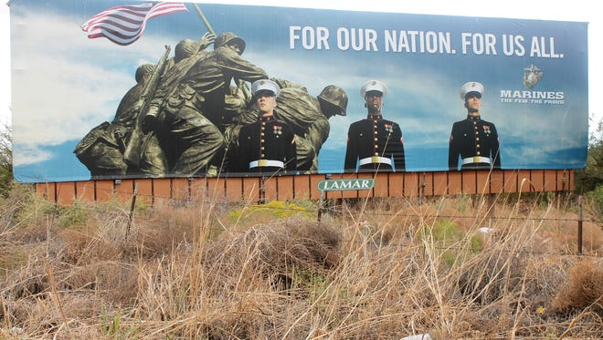 Harvey VanWinkle and his son cleaned up the area around this billboard, which is located on Highway 54/70 heading towards Alamogordo. VanWinkle was in the Navy during the Battle of Iwo Jima and just down the beach when this iconic moment took place.