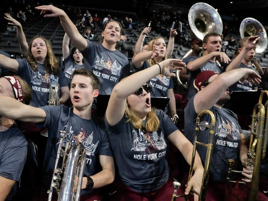 Members of the Florida State band cheer before the team's NCAA college basketball game against Virginia Tech during the quarterfinals of the Atlantic Coast Conference tournament, Thursday, March 9, 2017, in New York. (AP Photo/Julie Jacobson)
