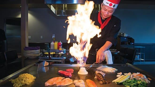 Hibachi Chef Joe Chen fires up a volcano of flame at Ninja Japanese Steakhouse soon after it opened in 2013. The restaurant's hibachi experience often attracts hundreds of guests per night.