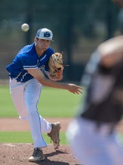 Dixie High School pitcher Tyson Fisher throws the ball