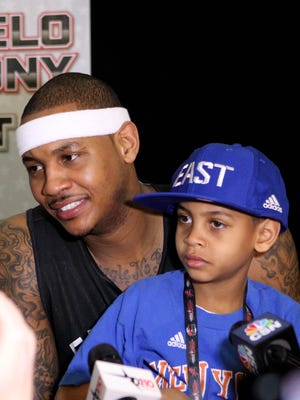 Carmelo Anthony of the New York Knicks holds his son Kiyan Carmelo Anthony during the media availability for the 2013 NBA All-Star Game.