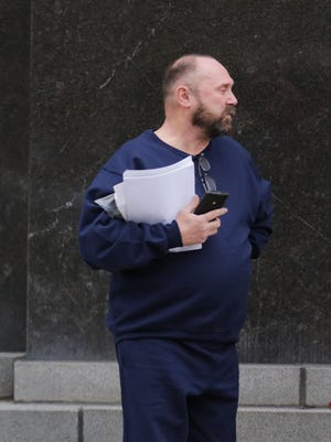 Arthur Rathburn of Grosse Pointe Park  is the  body parts broker that is  released on bond today pending the outcome of a case that alleges he sold arms, heads and legs infected with diseases to unsuspecting medical researchers. He walks out of Theodore Levin United States Courthouse on the Lafayette side Tuesday, Feb.  2, 2016.REGINA H. BOONE/Detroit Free Press