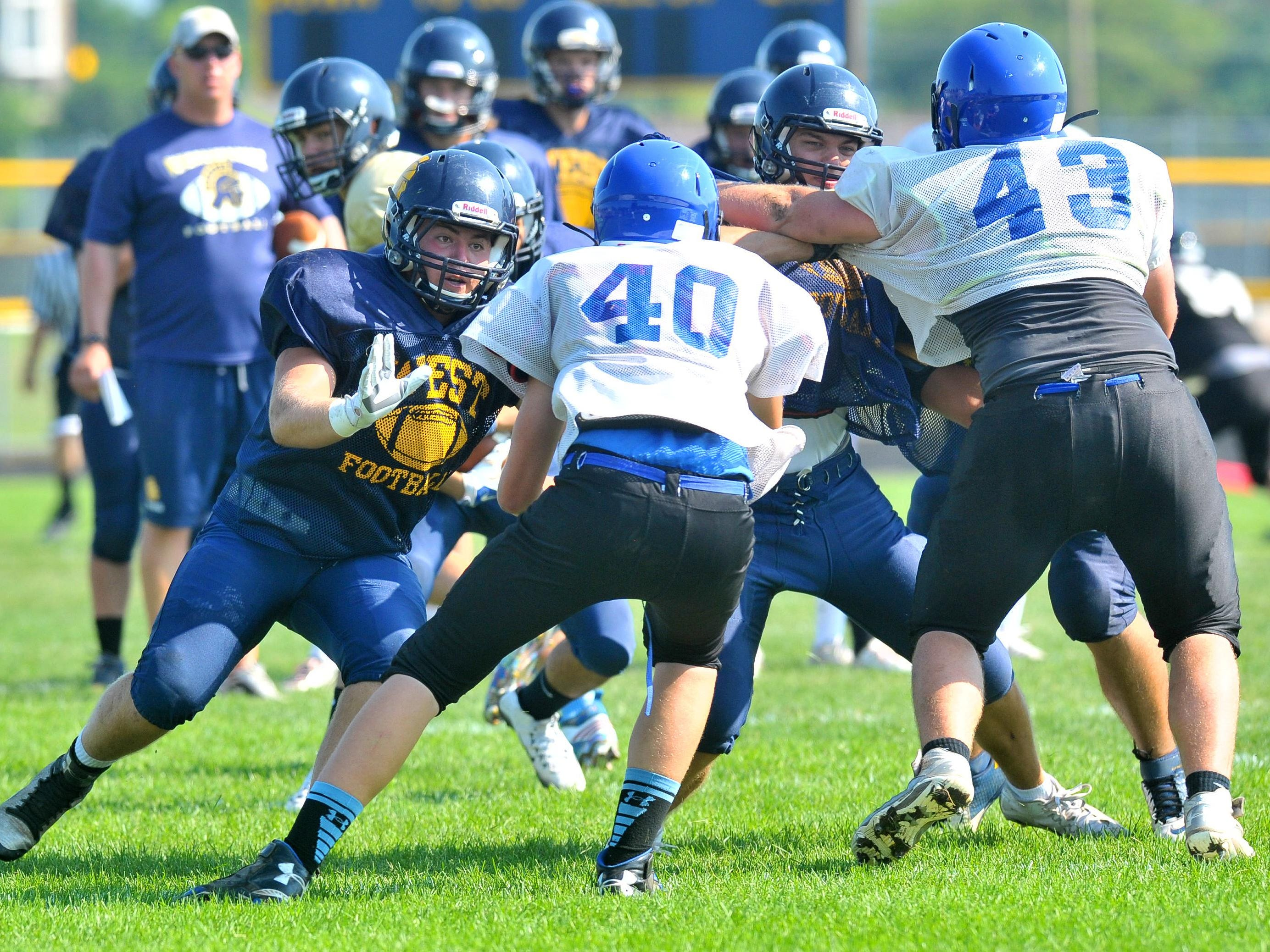 West vs. Merrill on scrimmage Friday afternoon at Wausau West High School football field.