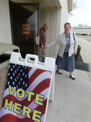 Voters exit the Kuhlman Center Thursday, April 28, 2016 at the Wayne County Fairgrounds in Richmond. Early voting centers have seen a steady stream of voters but not big crowds.