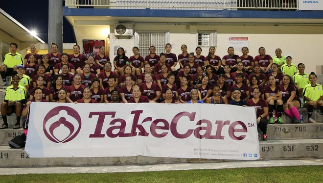 "Participants in the 6th Semiannual TakeCare ""Achieve Your Goals"" Women's Soccer Event pose for a group photo ahead of opening week activities Thursday evening at the Guam Football Association National Training Center. Photo courtesy of: Jill Espiritu"