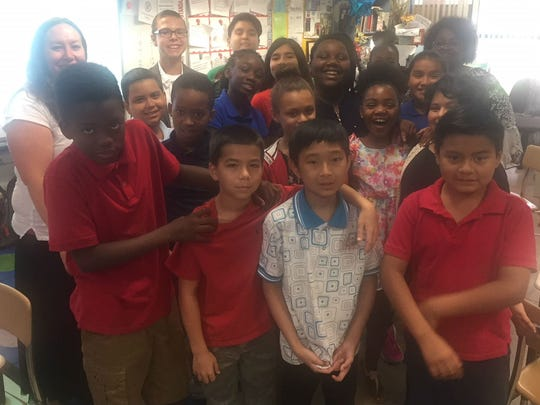 Stacey Miller (back left) and her fourth-grade students at Dodgertown Elementary School pose after hearing Laurence Reisman's four destinations during the school's first Destination Day May 17, 2018. Principal Aretha Vernette is at back right.
