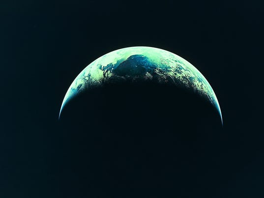 The Earth, partly illuminated