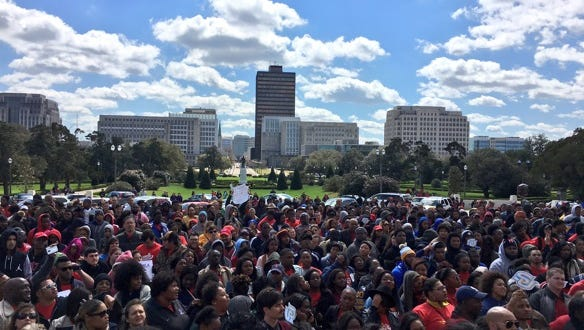 About 2,000 students from across Louisiana rallied on the capitol steps in protest of higher education cuts.