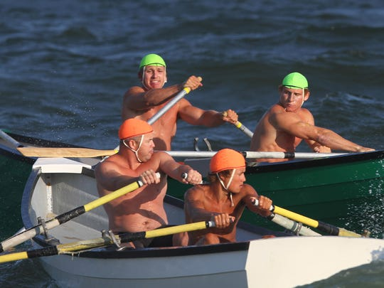 Long Branch's Connor Stimpson and Jake George (green caps) head out on their winning boat relay run, avoiding a collision on the rough row out, during the Spring Lake Lifeguard Tournament on Thursday, July 21, 2016.