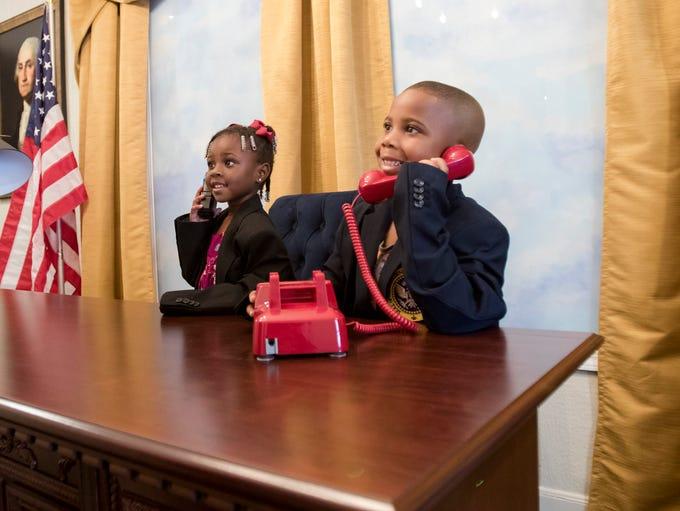 Jaida, 4, and Jackson Wade, 6, of Monroe, play in the
