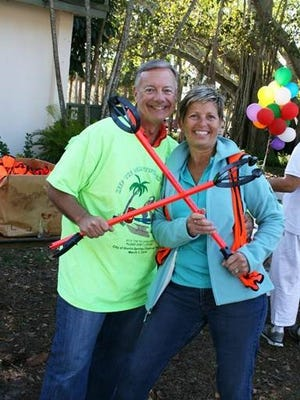 Bonita Springs City Manager Carl Schwing and Councilwoman Janet Martin pick up their supplies at the 2014 Keep the Beautiful in Bonita cleanup.
