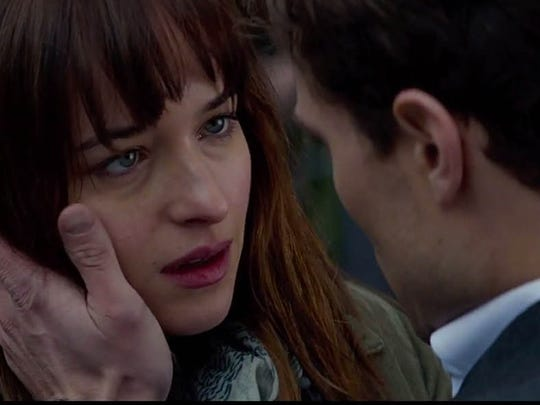 Christian Grey (Jamie Dornan) seduces Anastasia Steele