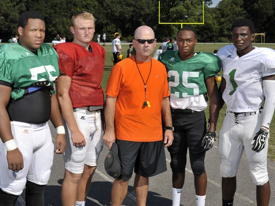 Member's of Catholic High's 2013 team (from L to R Nelson Hale, Cody Henry, head coach Greg Seibert, Emon Smith and Jeremy Reaves practice during August prior to the season.