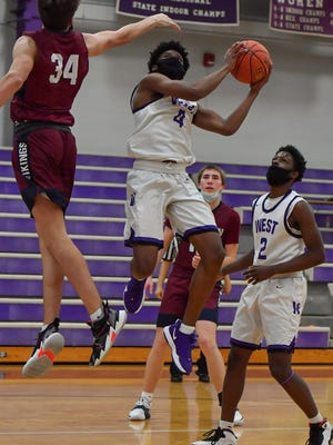 Topeka West's Elijah Brooks (4) led five Charger starters in double figures in Friday's 71-53 win at Seaman, scoring 21 points on 10-of-14 shooting.