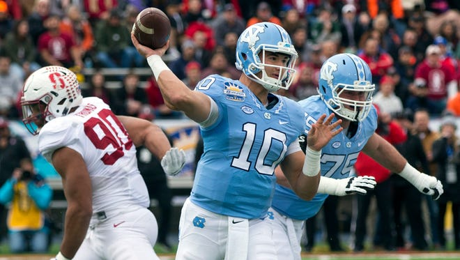 Former North Carolina QB Mitchell Trubisky (10) and ex-Stanford DE Solomon Thomas (90) seem to be potential No. 2 picks in the 2017 NFL draft.