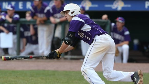 John Jay's Justin Drpich completes a swing during an