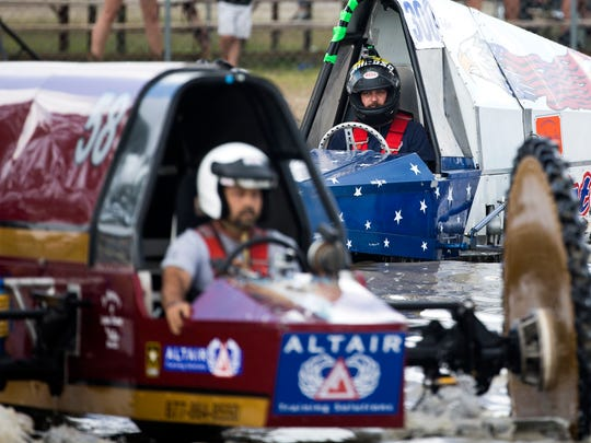 Tyler Johns and Eddie Chesser make their way to the starting line during the Swamp Buggy Races on Saturday, March 25, 2017 at Florida Sports Park in East Naples.