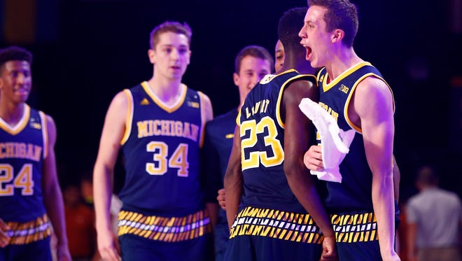 Michigan guard Caris LeVert (23) and guard Duncan Robinson (right) celebrate at the end the first half against Texas during the 2015 Battle 4 Atlantis in the Imperial Arena at the Atlantis Resort Friday.