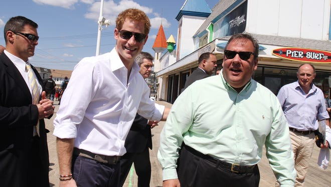 "Prince Harry and Gov. Chris Christie do a ""walkabout"" on the rebuilt Seaside Heights boardwalk on May 14, 2013."
