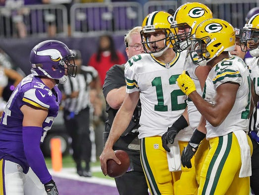 Green Bay Packers quarterback Aaron Rodgers (12) has