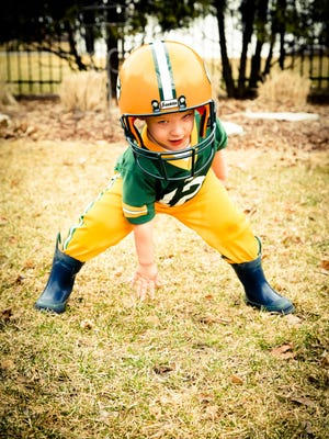 This photo of Appleton 3-year-old Declan Johnson was the winning entry in the 2015 Packers Ticket Takeover Contest.