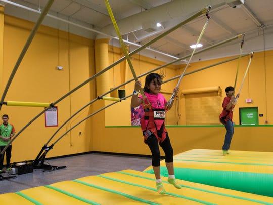 Emilie Herrera, 5, jumps on the harness vault at Rockin' Jump trampoline park on September 30, 2017.