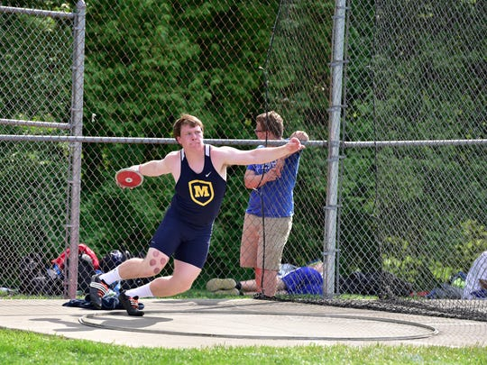 Ryan Smith of Moeller won the shot put and discus at the GCL-South track meet.