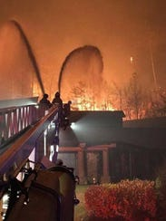 Fire crews struggle to fight flames consuming the Park Grill in Gatlinburg the night of Nov. 28, 2016.
