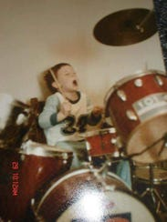 Drummer and vocalist John Hoffman, age 38, playing